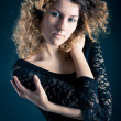 Close up portrait of beautiful curly girl with black lace dress — Stock Photo