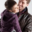Stock Photo: Young father and son playing together portrait. Studio shot