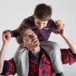 Young father and son playing together portrait. Studio shot — Stock Photo #15655371