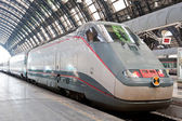 Central railway station with fast speed train waiting on the platform. Milan, Italy — Stock Photo