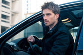 Young elegant man portrait with luxury car — Stock Photo