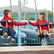 Stock Photo: Two brothers swinging together