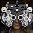 Optometrist diopter with girl - Stock Photo