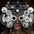 Optometrist diopter with girl — Stock Photo #16289433