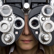 Optometrist diopter with girl — Stock Photo
