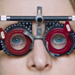 Eye examination with blue eye girl - Stock Photo