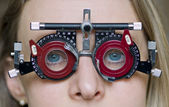 Eye examination with blue eye girl — Stok fotoğraf