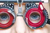 Eye examination with blue eye girl — Stock Photo