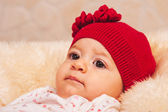 Four months old baby with red hat — Stock Photo