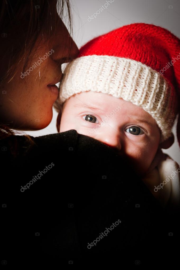Mother and baby wearing Christmas hat — Stock Photo #16289915