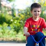 Six year old kid outdoor on bike — Stock Photo #16290671