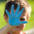 Happy child showing his colorful hands — Stock Photo