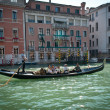VENICE, ITALY - SEPTEMBER 31: Tourists on a Gondola, September 31, 2011 in Venice, Italy. The city has an average of 50,000 tourists a day and its one of the worlds most internationally visited city - Stock Photo