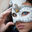 Stock Photo: Beautiful girl with white mask in Venice