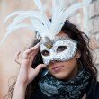 Beautiful girl with white mask in Venice — Stock Photo #16292183