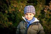 Happy kid outside in a park. Winter time — Stock fotografie