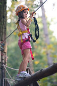 Young girl climbing trees in Dolomites, Italy — Stock Photo