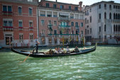 VENICE, ITALY - SEPTEMBER 31: Tourists on a Gondola, September 31, 2011 in Venice, Italy. The city has an average of 50,000 tourists a day and its one of the worlds most internationally visited city — Stock Photo