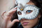 Beautiful girl with white mask in Venice — Stock Photo