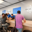 BOLOGNA, ITALY - AUGUST 6: visiting the Apple Store on August 6, 2012 in Bologna, Italy. Apple has 363 stores worldwide, with global sales of 16 billion US dollars in merchandise in 2011 - Stock Photo
