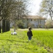 Country scenery, kid with ducks — Stockfoto