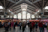 VALENCIA, SPAIN - MARCH 30: Shopping in the Colon market. The building was opened on Christmas eve 1916 to great public acclaim. March 30, 2012 in Valencia, Spain — Stock Photo
