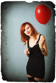 Vintage portrait of beautiful redhead caucasian girl with heart balloon — Stock Photo