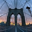 Brooklyn Bridge in New York at dusk - Stock Photo
