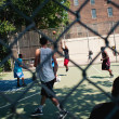 NEW YORK CITY - JUNE 28: West 4th Streets iconic basketball court - Stock Photo