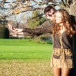 Romantic young couple outdoors in autumn park — Stock Photo