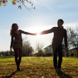 Romantic young couple silhouette outdoors with back light — Stock Photo