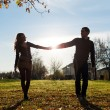 Stock Photo: Romantic young couple silhouette outdoors with back light