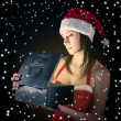 Christmas woman opening gift box on black and stars background — Stock Photo #18446933