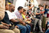 NEW YORK CITY - JUNE 27: Commuters in subway wagon — Stok fotoğraf