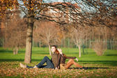 Romantic young couple relaxing outdoors in autumn park — Stock Photo