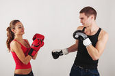 Sporty couple fighting with boxing gloves — Stock Photo