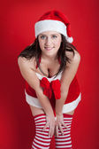 Christmas woman portrait with generous neckline on red background — Stock Photo