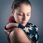 Young woman portrait with american flag scarf against grey background — Stock Photo