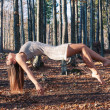 Levitation portrait of young woman in the woods — Stock Photo #18707875