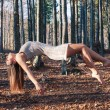 Levitation portrait of young woman in the woods - Stock Photo