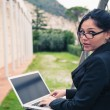 Young businesswoman using tablet computer outdoors — Stock Photo