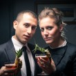 Attractive elegant young couple drinking a cocktail — ストック写真