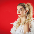 Beautiful blonde woman close up portrait with white ostrich feat — Stock Photo