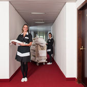 Two chambermaid women cleaning in a hotel — Stock Photo