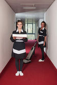 Two chambermaid women during service in a hotel — Stock Photo