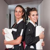 Two chambermaid women portrait in a hotel — Stock Photo