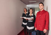 Porter and chambermaid women during service in a hotel — Stock Photo