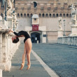 Young beautiful ballerina dancing on Castel Santangelo bridge in Rome, Italy — Stock Photo