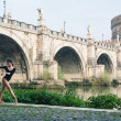 Young beautiful ballerina dancing under Castel Santangelo bridge in Rome, Italy — Stock Photo