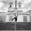 Young beautiful ballerina dancing on the Spanish Steps in Rome, Italy - Stock Photo